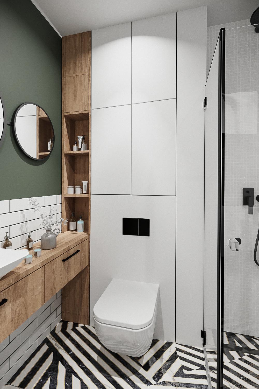 10 projektant wnetrz 482 mieszkanie krakow lazienka biala zabudowa geberit czarne elementy zielona sciana prysznic z odplywem liniowym