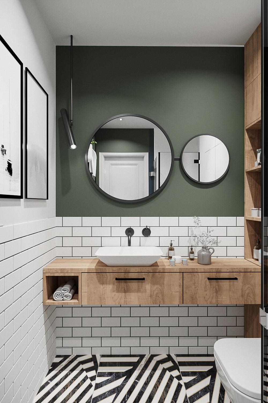 8 projektant wnetrz 482 mieszkanie krakow lazienka biale plytki cegielki drewniana szafka pod umywalka zielona sciana okragle lustra